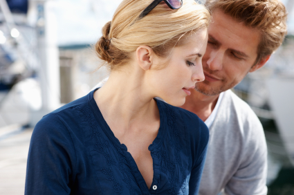 Portrait of young couple having romantic time together at harbor